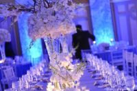21 white and silver winter tables with lots of candles and white flowers