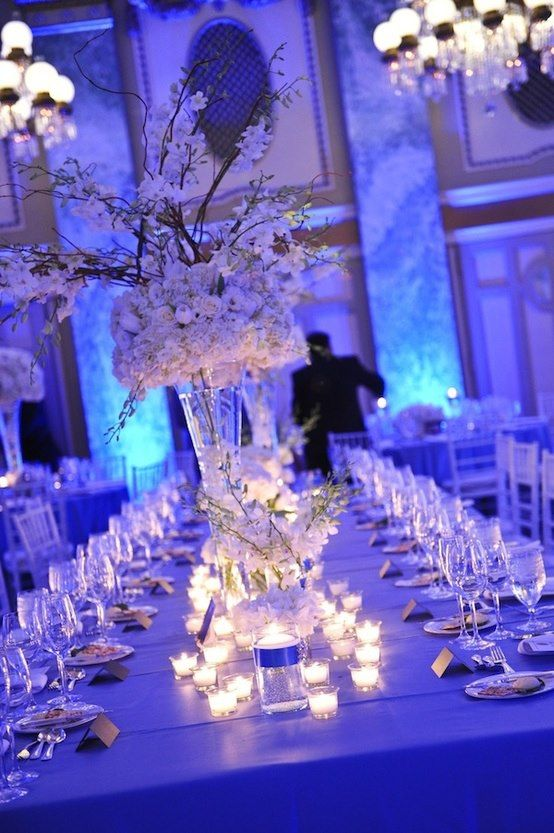 White And Silver Winter Tables With Lots Of Candles And White Flowers