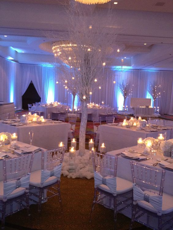 sparkling reception with crystal trees and lots of candles to create an ambience