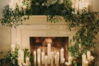 23 a fireplace with candles and greenery used as an altar will make your ceremony more intimate and cozier