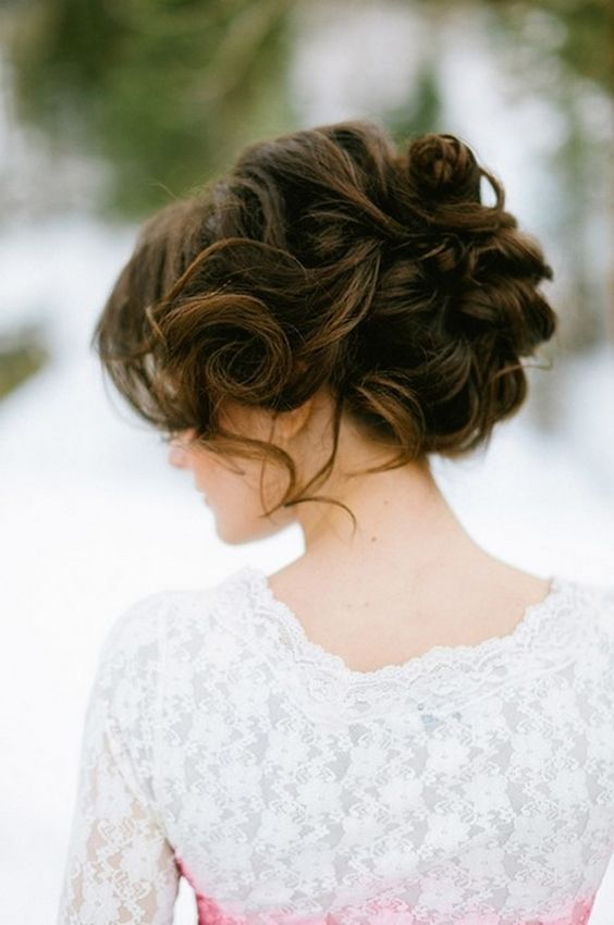 a messy updo is a hot trend this year and looks effortlessly chic