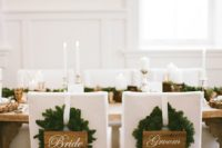 23 fir wreaths with signs instead of usual chair decor