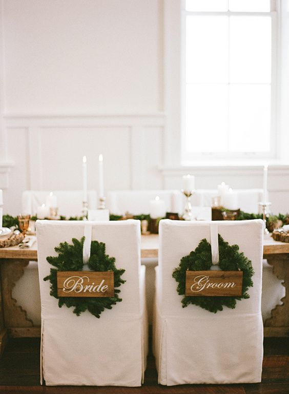 fir wreaths with signs instead of usual chair decor