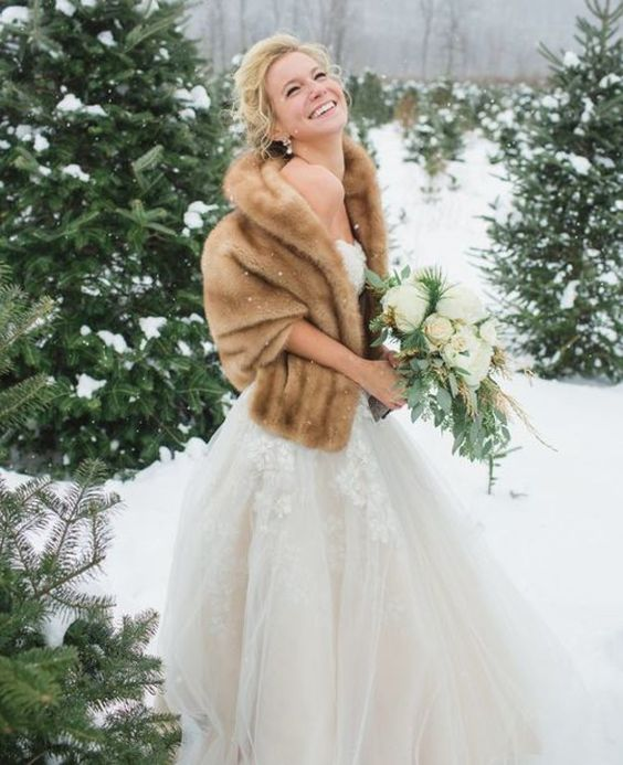 cozy brown fur cover up for a chic bride