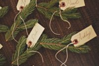 24 fir branches as place card holders