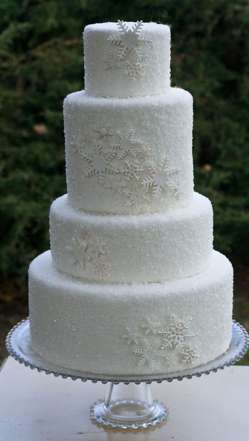 white fondant with sanding sugar and white snowflakes