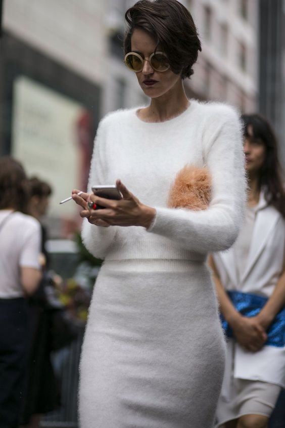 fine knit white angora sweater with a scoop neck and a skirt