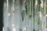 25 fir branch garlands with feathers and gold dots will give your wedding a boho feel