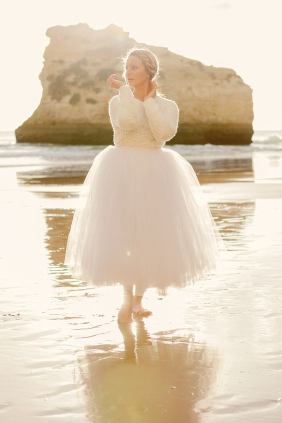 a bridal separate with a tulle skirt and a sweater is a modern and fresh idea