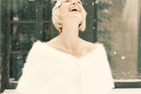 26 bride in the snow wearing a winter wedding faux fur coverup