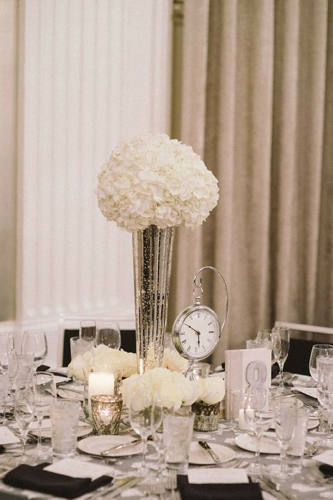 elegant black and white tablescape with a clock to remind