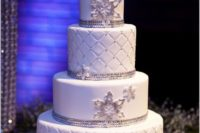 26 glamorous winter wedding cake with silver and snowflakes