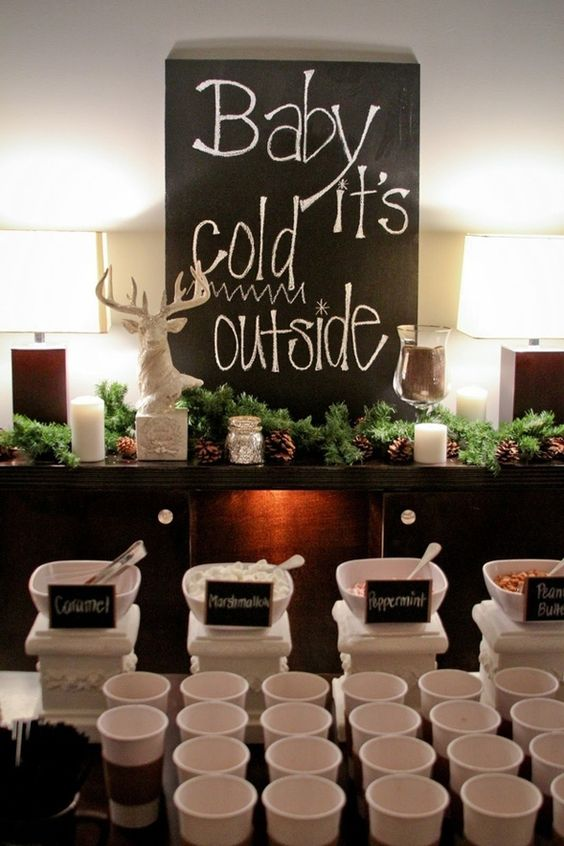 great idea for decorating a hot cocoa bar with fir, chalkboards and pinecones