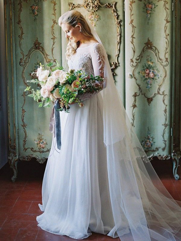 princess-style gown with lace appliques and a tulle skirt by Paolo Sebastian