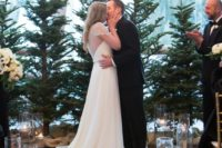 27 evergreen trees used for a ceremony backdrop