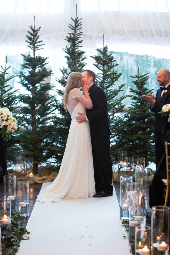 evergreen trees used for a ceremony backdrop