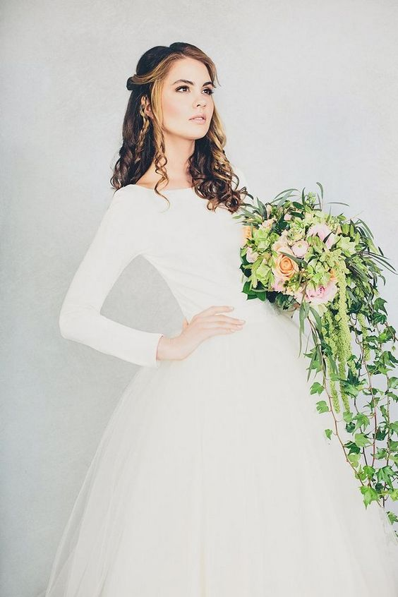 simple wedding dress with a plain top and a tulle skirt for a modern bride