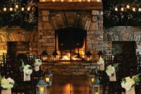 27 working candlelit fireplace used an altar to maximize coziness at a rustic wedding