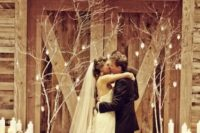 28 branches decorated with candles and birch log cnadle holders for a rustic big day