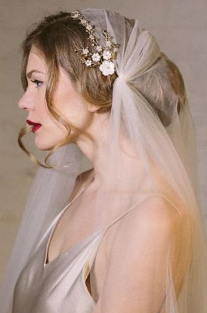 juliet cap accessorized with a headpiece with an updo