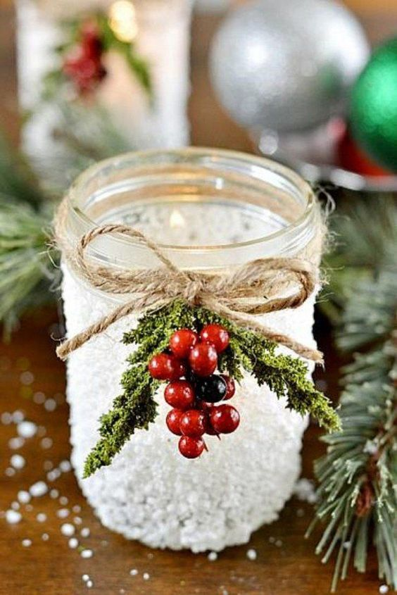 faux snow candle lantern decorated with fur and berries