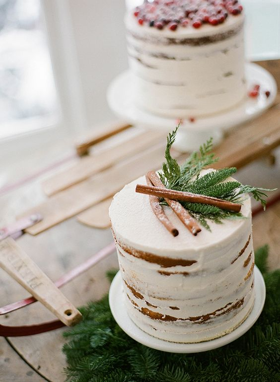 lightly frosted woodland wedding cake with cinnamon sticks and fir