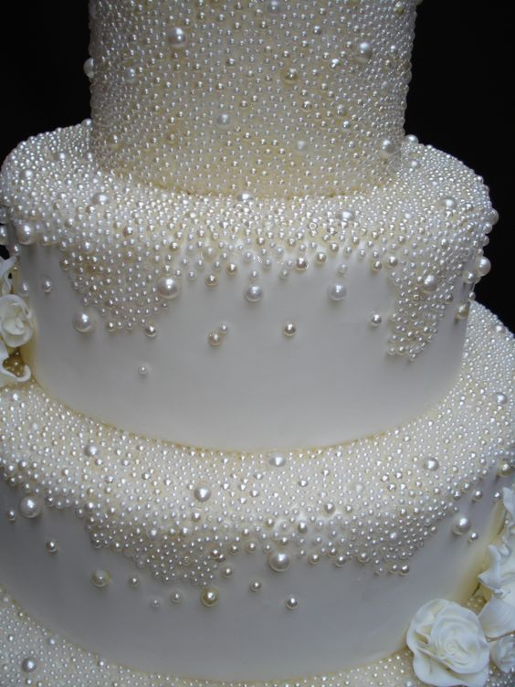 pearl-decorated wedding cake imitating snowballs