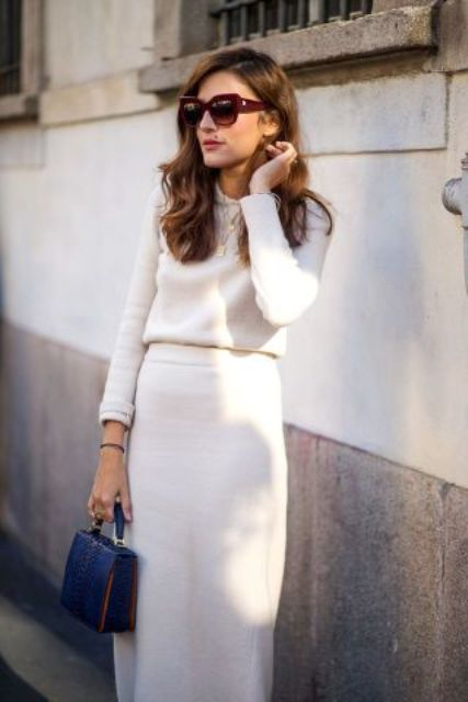 retro style with a white maxi skirt and a plain sweater