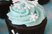 30 chocolate cupcakes with ice blue frosting and snowflakes