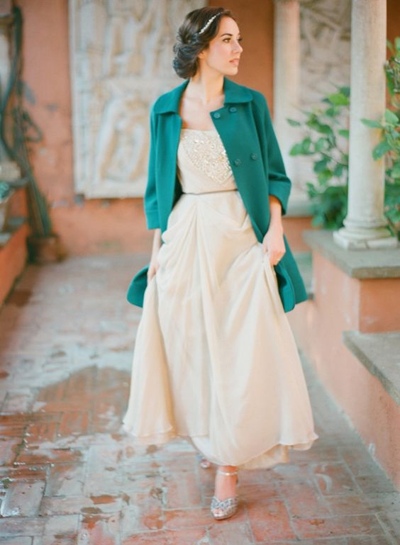 emerald coat creates a bold accent and highlights the vintage look of the bride