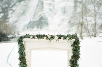 30 outdoor winter altar decorated with a eucalyptus garland and blush blooms