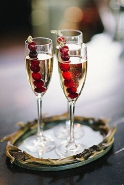 champagne with cranberries as a cocktail for your bar