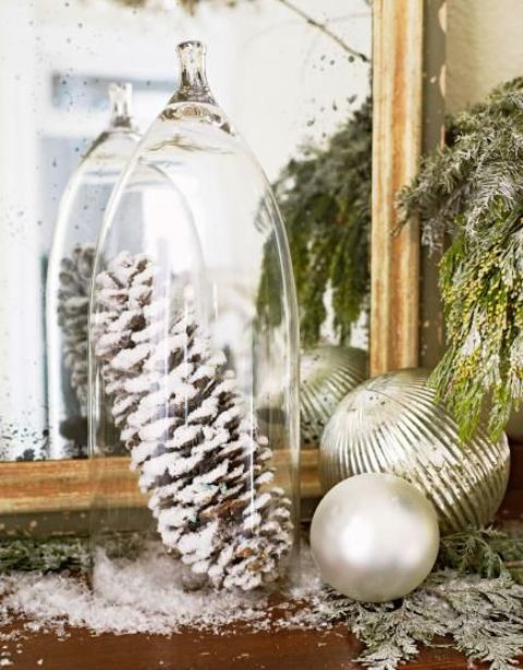 frosted pinecones under a cloche will bring a cozy touch to your decor
