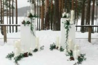 31 outdoor winter altar with candles and greenery that shows up the scenery