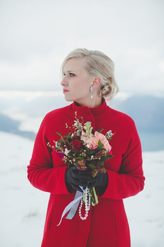 red coat will keep you perfectly warm and can make a bold statement in your bridal look