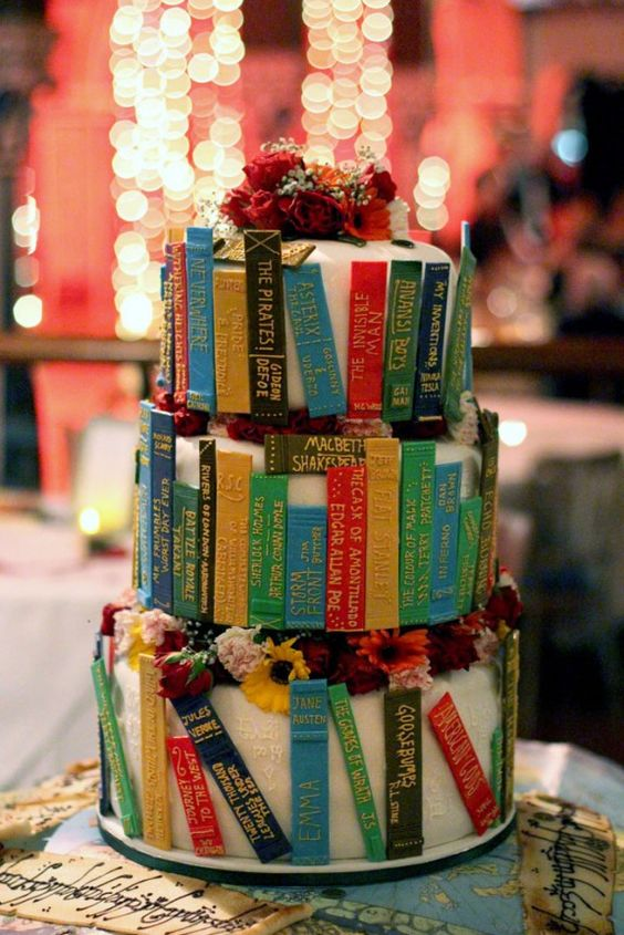 book spines wedding cake topped with flowers