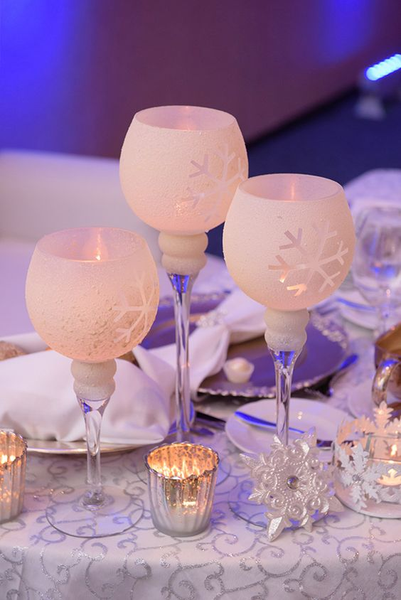 elegant frosted glass candle holders with snowflakes