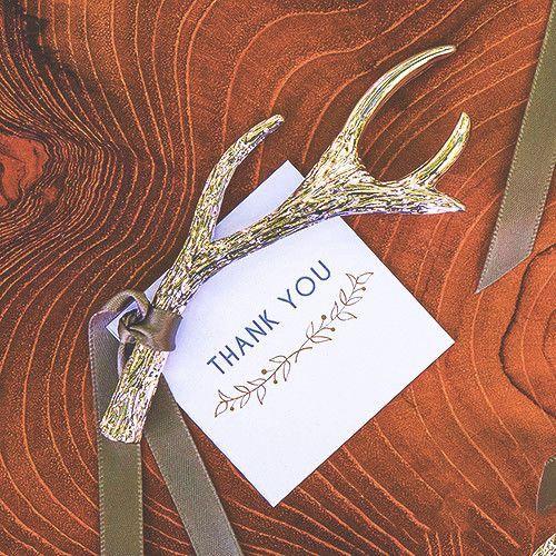 antler bottle opener as a woodland wedding favor