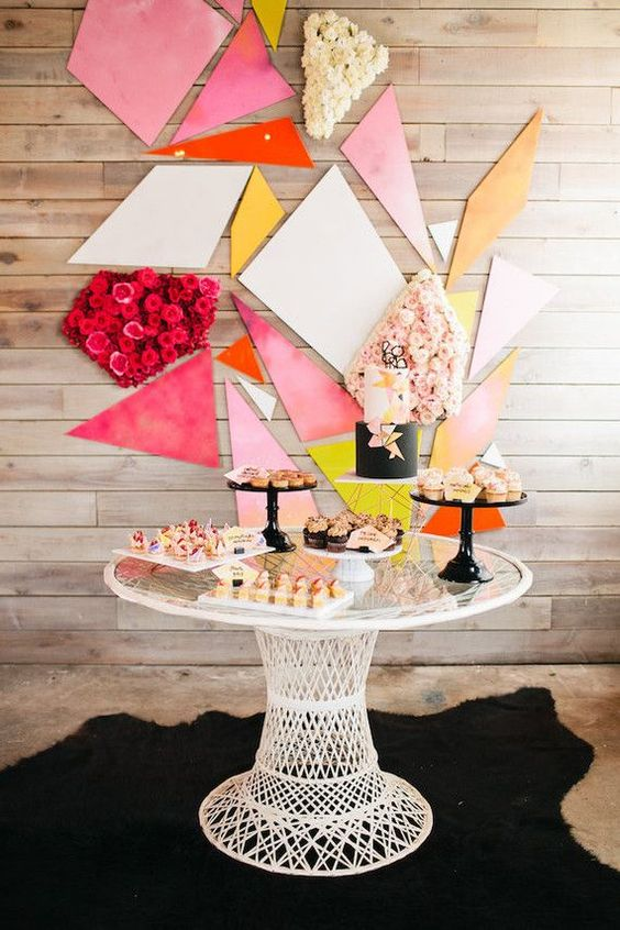 bold dessert table decor with floral parts