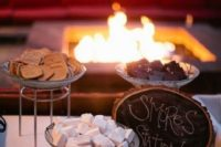37 s'mores station with a fire pit behind