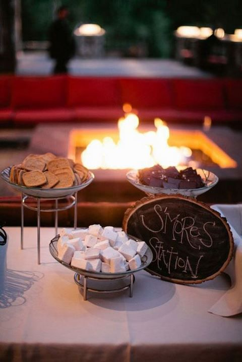 s'mores station with a fire pit behind