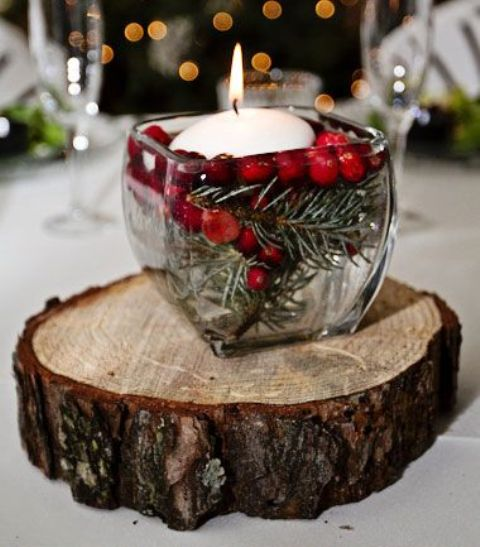 berries and fir with a floating candle