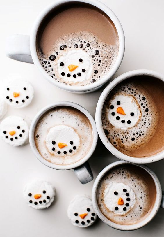 hot chocolate with snowman marshmallows to add a winter touch