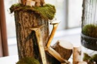38 moss and moss balls with wood logs and candles for decor