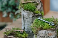 39 vintage keys on moss placed on wood logs for decor