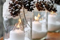 41 snowy pinecones and lanterns as a seasonal accent