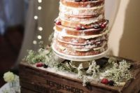 43 naked wedding cake topped with fresh berries and fruit