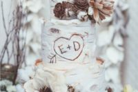44 wedding cake looking like a birch one decorated with cotton, pinecones and fabric owl toppers