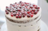 45 frosted wedding cake topped with cranberries and sugar powder