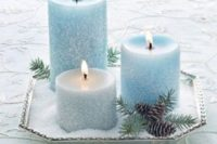 46 snowy ice blue candles on a tray with faux snow